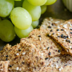 almond crackers closeup with green grapes