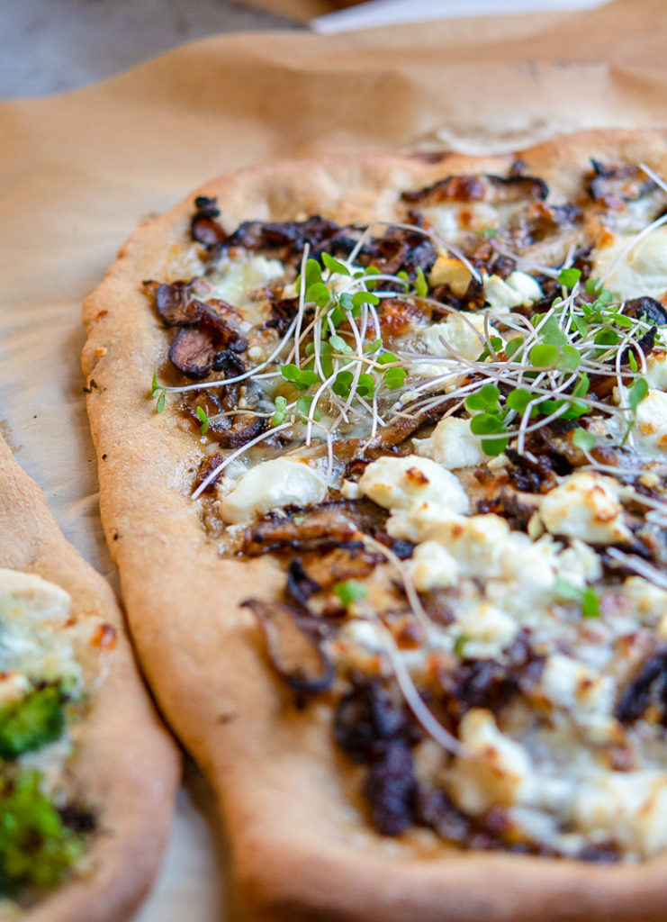 White whole wheat pizza with mushrooms and goats cheese