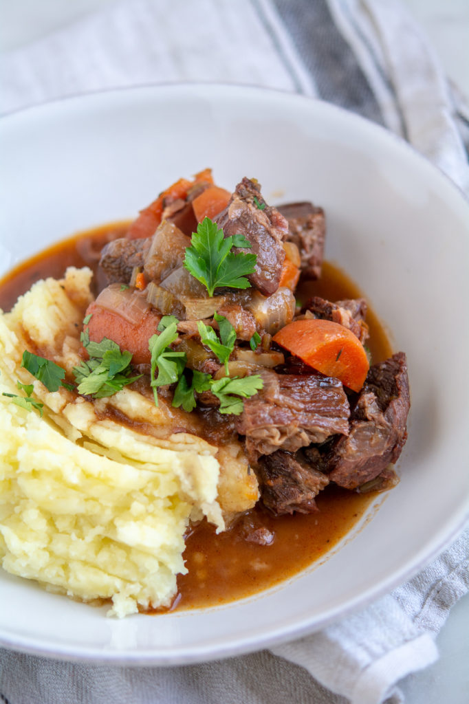Guinness Beef Stew with mashed potatoes in a bowl