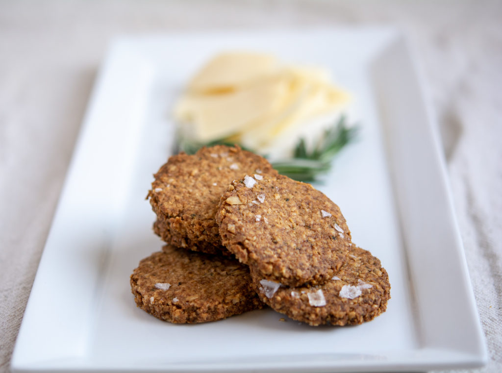 photo of rosemary oat crackers on a white platter