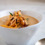 Photo of rutagaga and chipotle soup with rutabaga fries on top