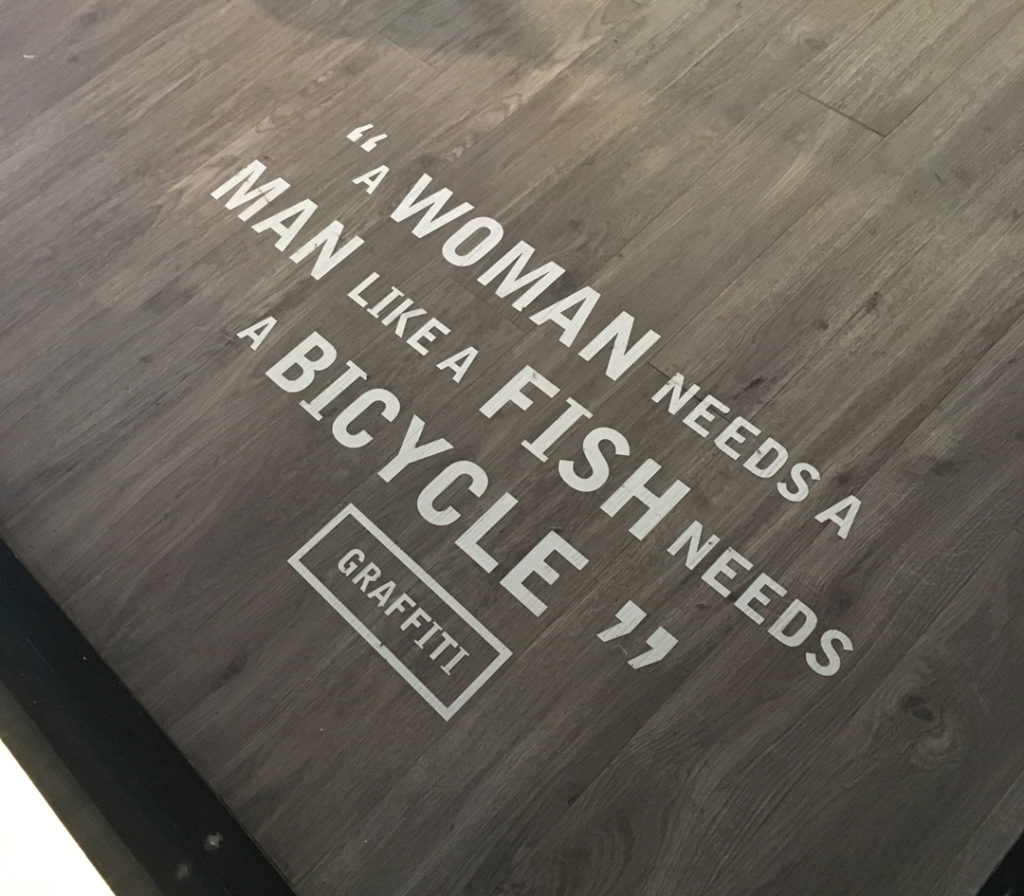 "quote from Guinness Storehouse: ""A woman needs a man like a fish needs a bicycle"" by Graffiti"