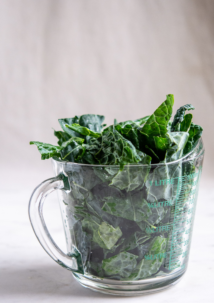 dinosaur kale in a measuring cup