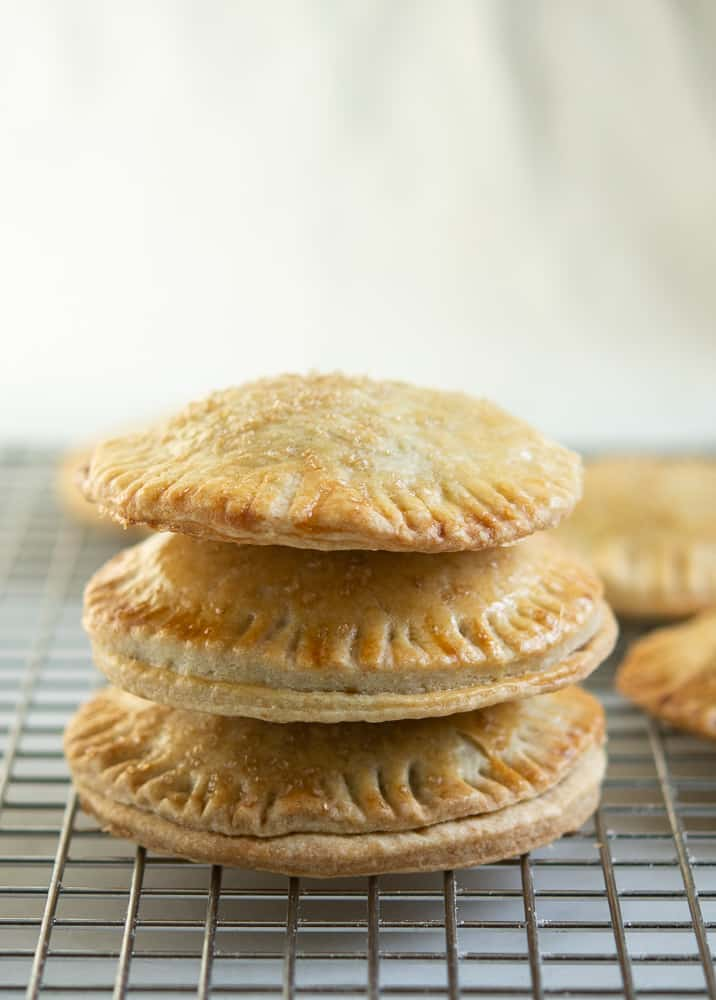 Pumpkin Hand Pies stacked up three tall on baking rack