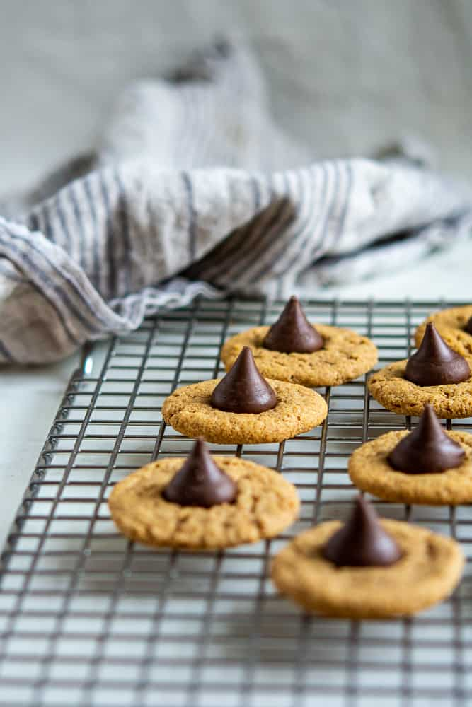 Almond Butter Bloosom Cookie photo on a baking rack with dishcloth