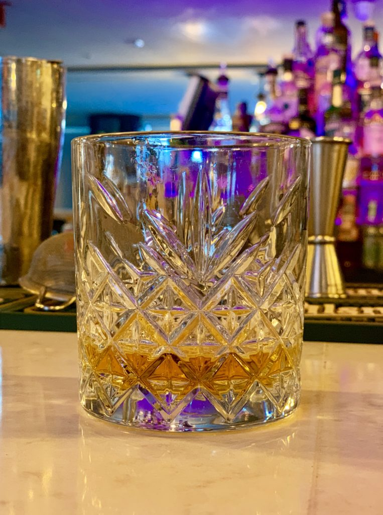 photo of a glass of greenspot whiskey