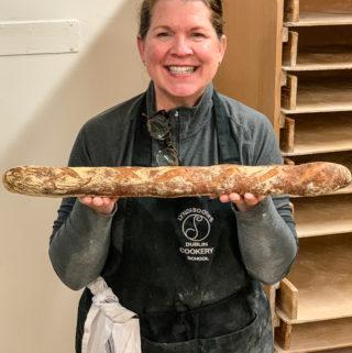 Shelagh holding a freshly baked bagette