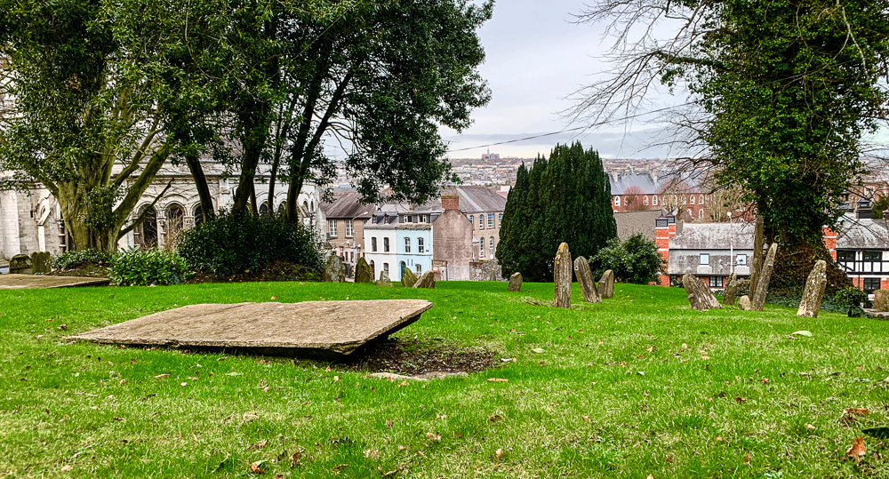 photo of grave with cork city in the background