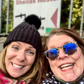 Two Sheila/Shelagh's in front of Sheila's Hostel.