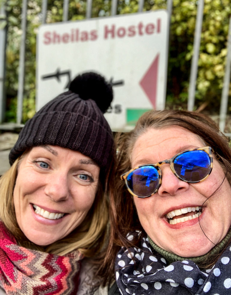 Two Sheila/Shelagh's in front of Sheila's Hostel.