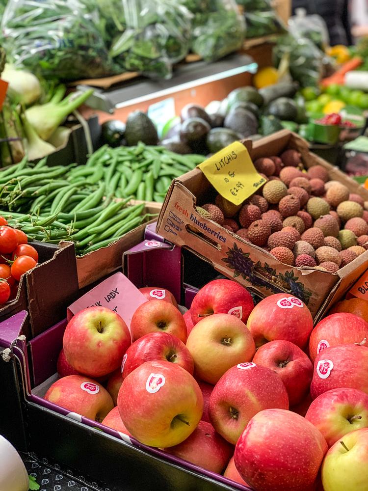 produce (apples, beans, litchi fruit) at English market