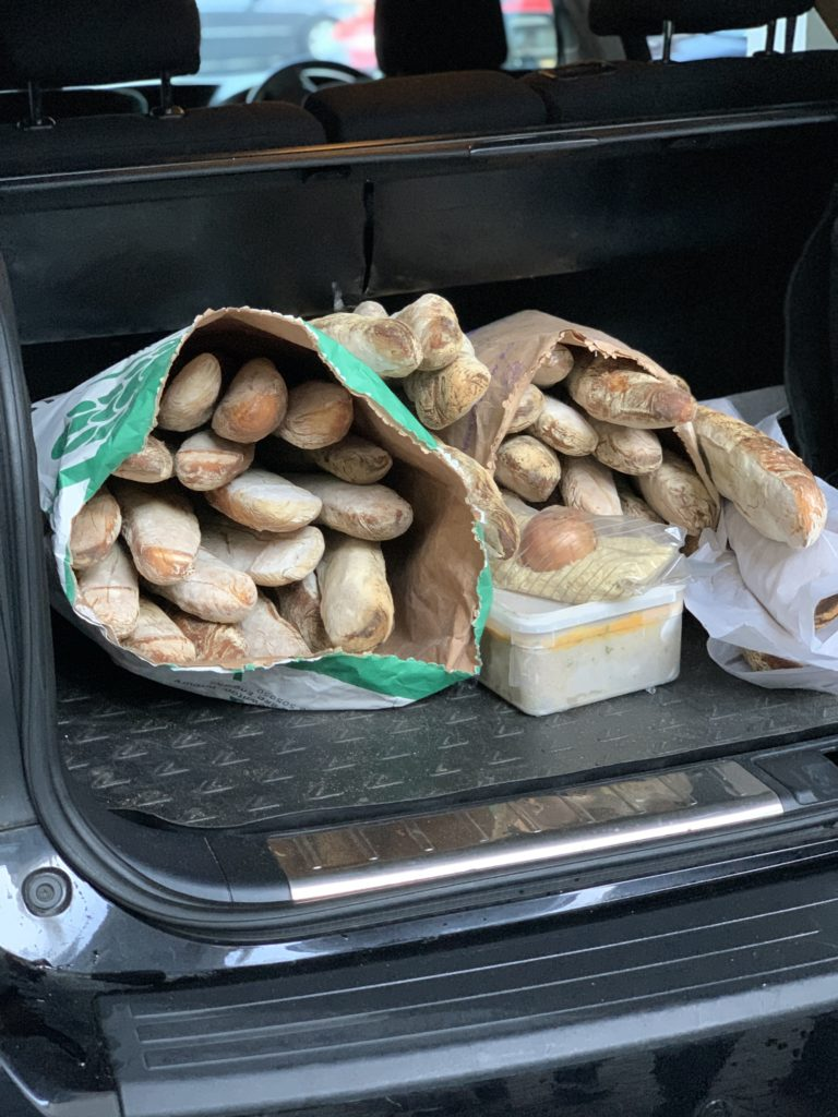 photo of bread in the back of the car