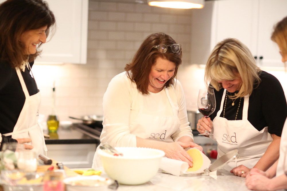 photo of Shelagh cooking with students