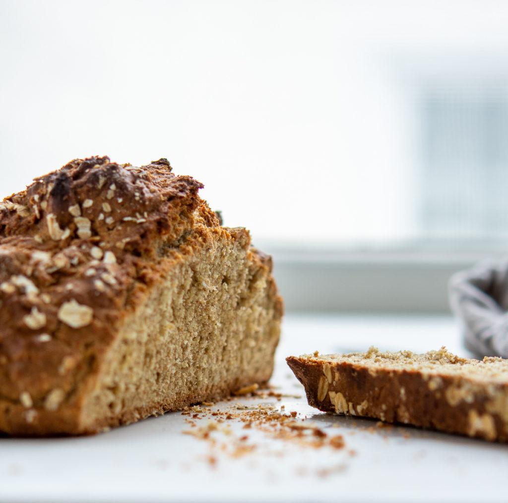 Loaf of irish soda bread with a slice