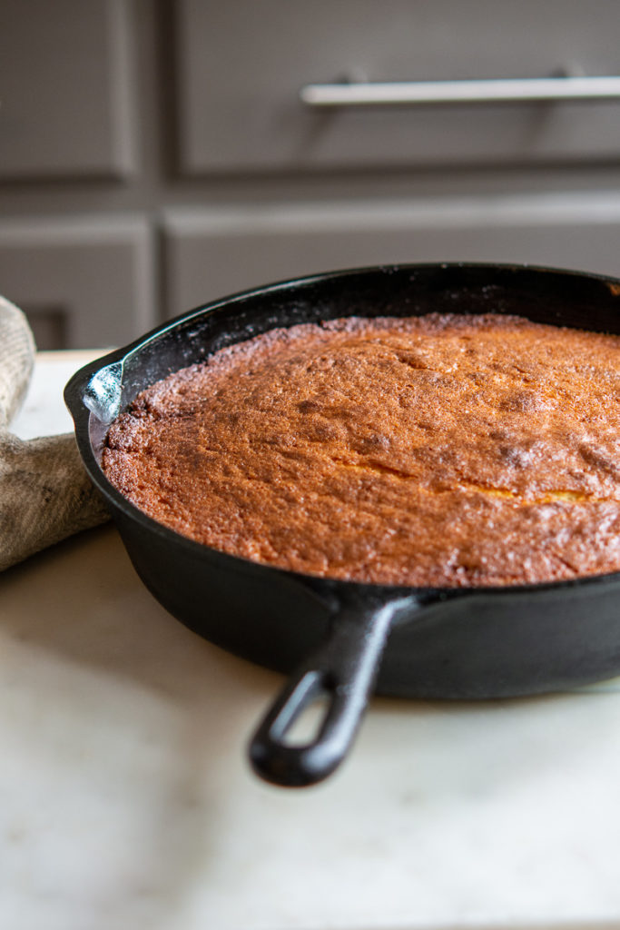 Pineapple Upside-Down Cake in a cast iron pan, right out of the oven