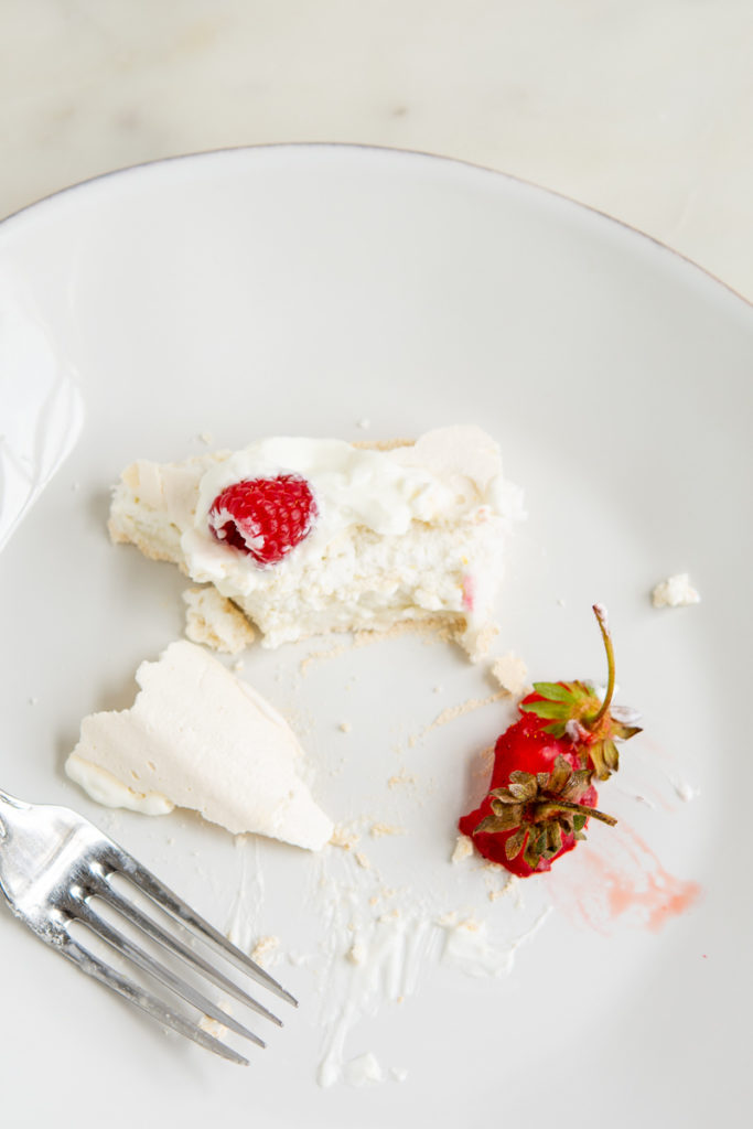 eaten pavlova cake with berry stems