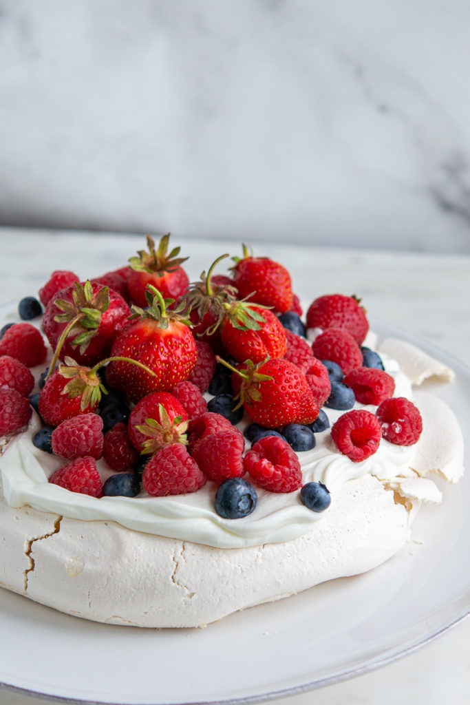 full close up shot of berry pavlova