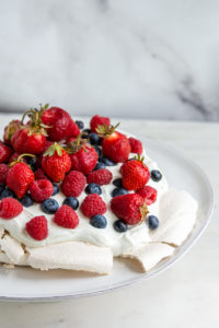 cropped view of berry pavlova
