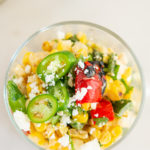Overhead shot of Grilled Elote Corn Salad in glass dish