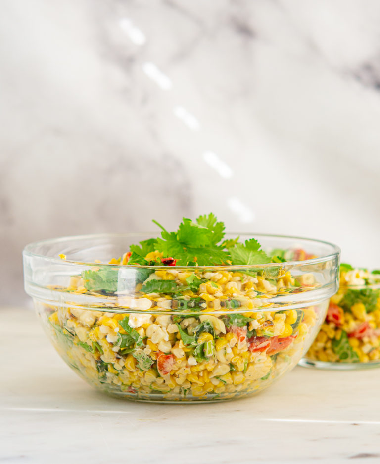 Large glass bowl of Grilled Elote Corn Salad