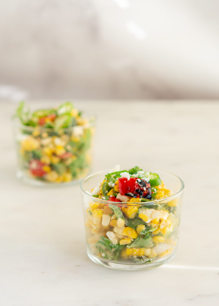 Grilled Elote Corn Salad in a small glass dish