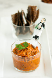 Roasted Romesco Sauce on a tray with chips