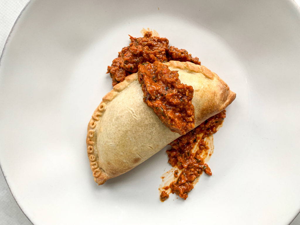 Roasted Romesco Sauce on a Quebracho empanada