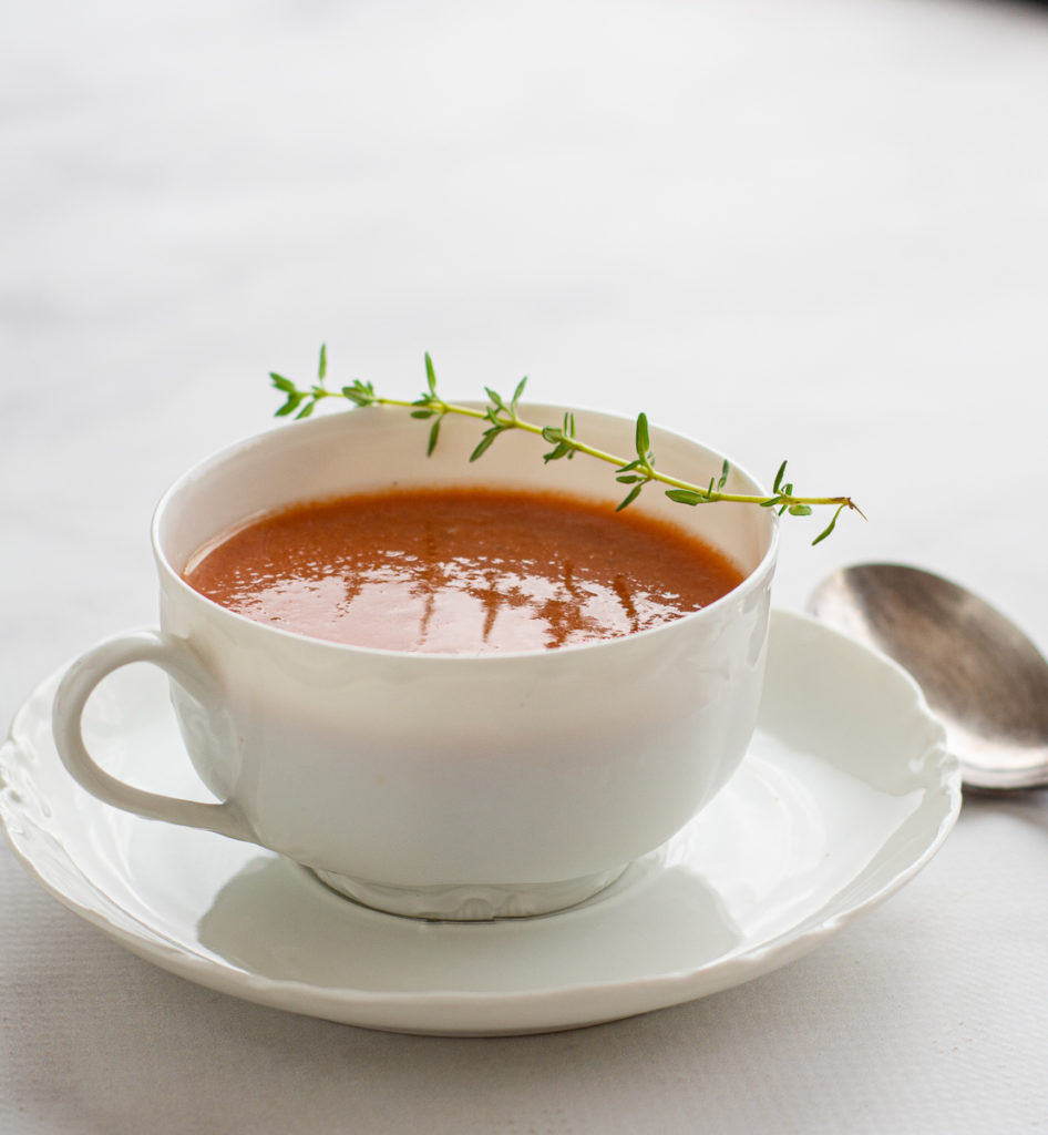 Grilled Gazpacho in a dainty cup, backlit