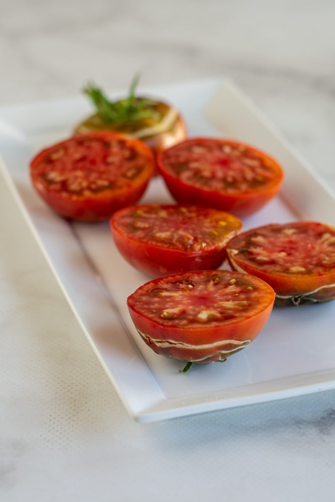 cut tomatoes for Grilled Gazpacho