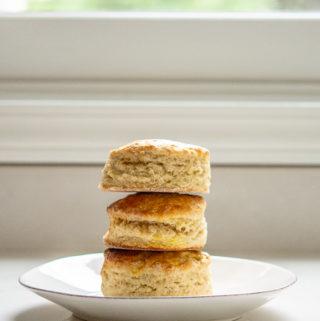 three irish scones stacked on a plate