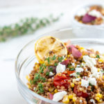 Israel Couscous Tomato and Corn Salad with Goat Cheese with lemon in the bowl